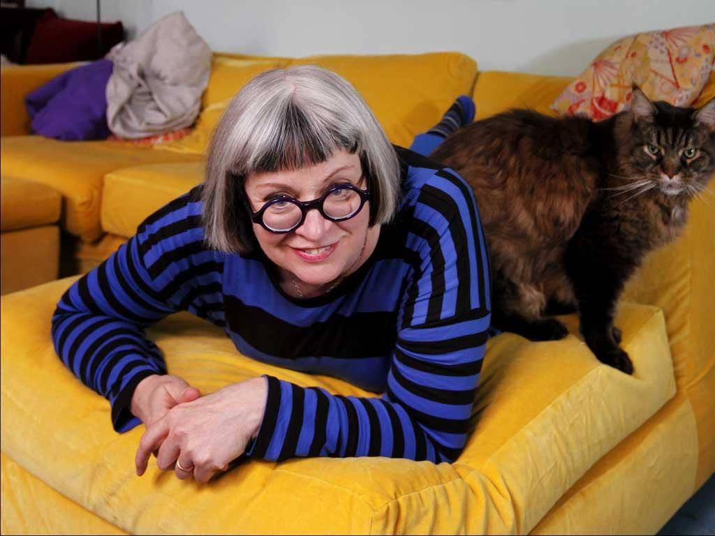 Talking cure: Philippa Perry with cat Baddie in the London home she shares with the artist Grayson Perry