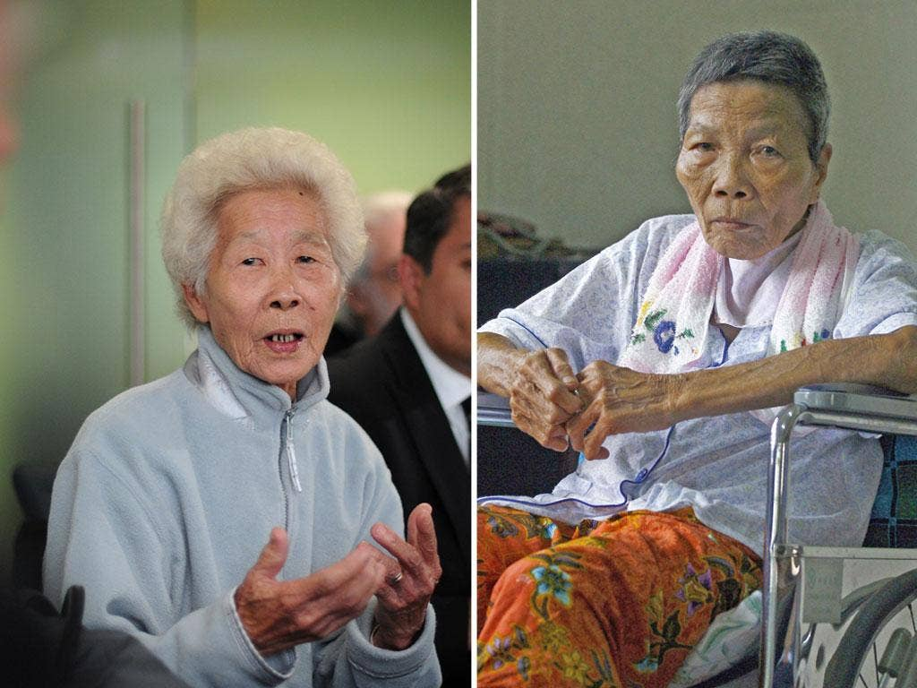 Lim Ah Yin,left, whose father was one of 24 Malaysian rubber plantation workers killed in 1948 and eyewitness Tham Yong, who died in 2010