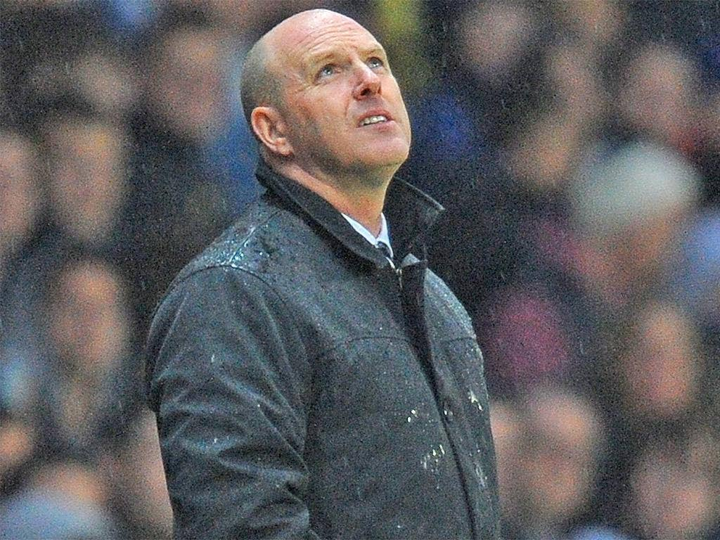 Rovers' Steve Kean volunteered himself as the wally without a brolly against Wigan