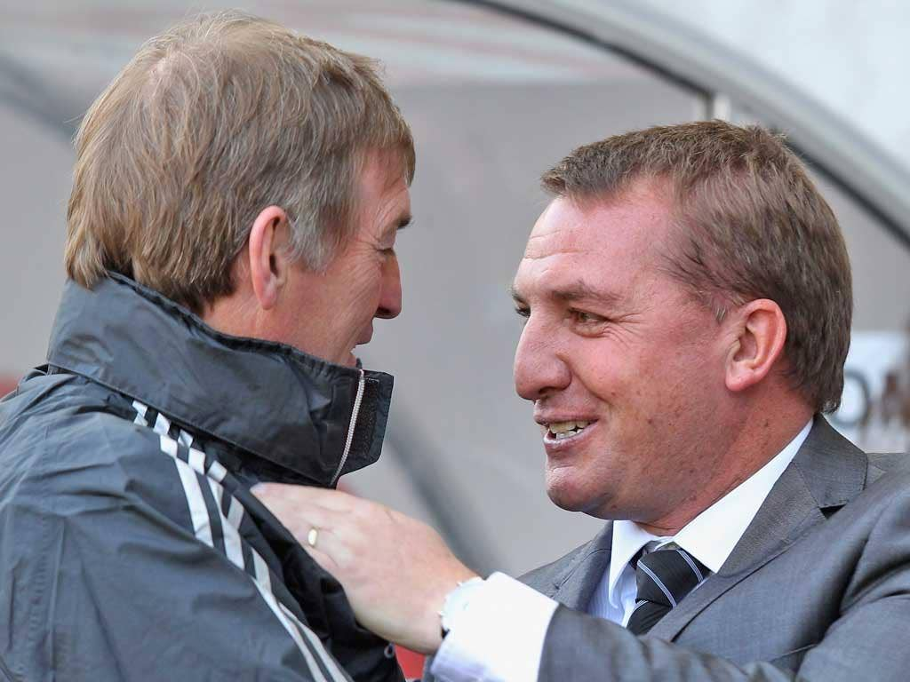 Brendan Rodgers (right) and Kenny Dalglish exchange words yesterday