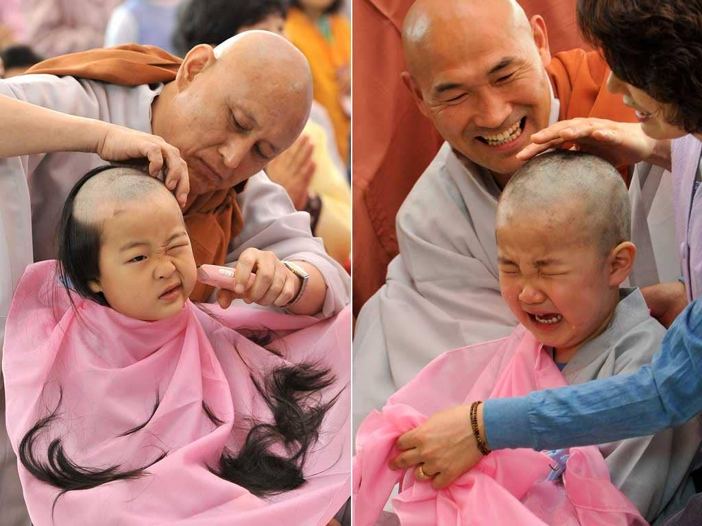South Korean boys get their heads shaved by Buddhist monks