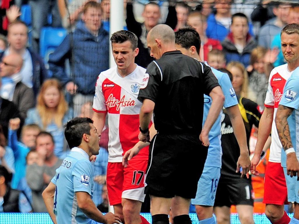 City's Sergio Aguero is felled by Joey Barton on Sunday