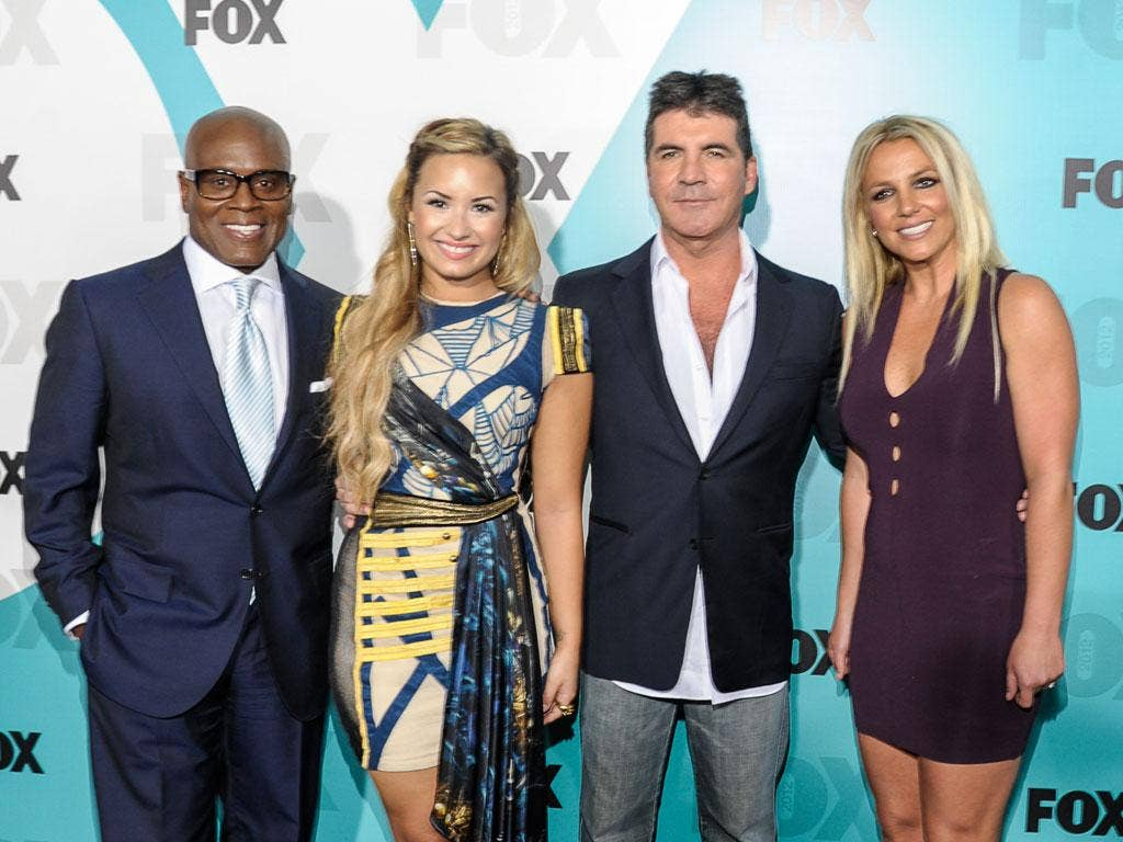X Factor judges LA Reid and Simon Cowell (left and second right) with new additions Demi Lovato and Britney Spears (second left and right)