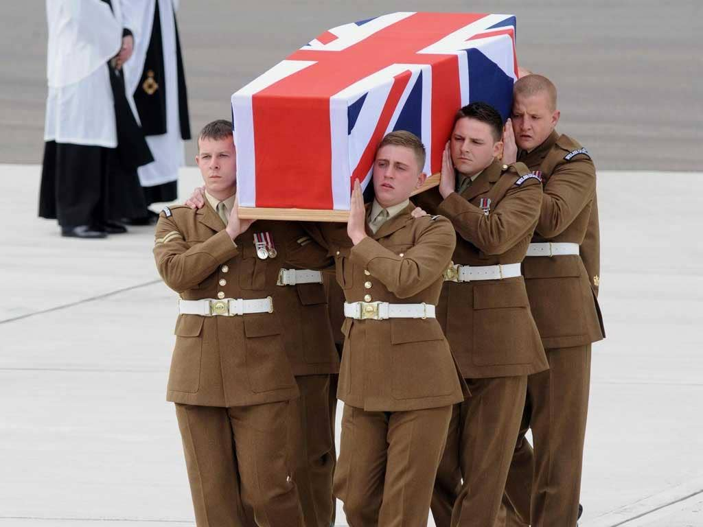 A coffin containing the body of L/Cpl Lee Davies at RAF Brize Norton yesterday
