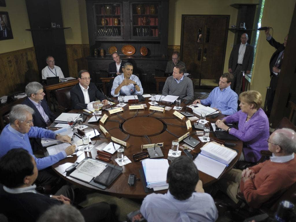 Barack Obama chairs a G8 summit plenary session today