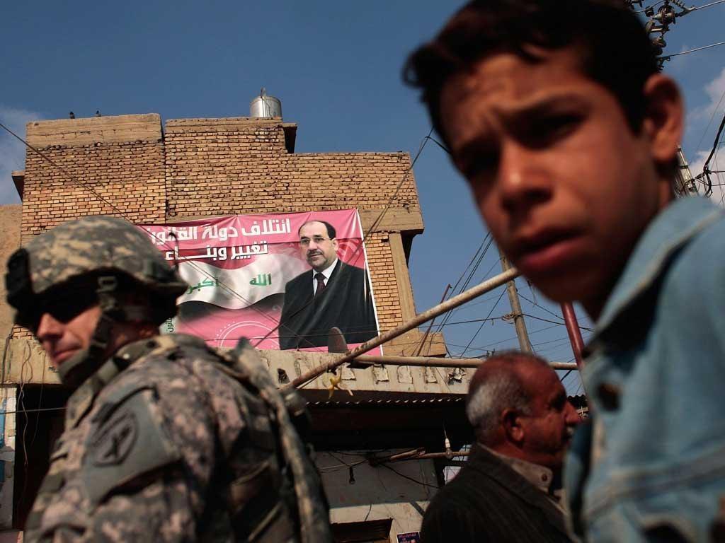 A campaign poster for Nouri al-Maliki, Iraq's increasingly dictatorial premier, in Musayyib, Babil province