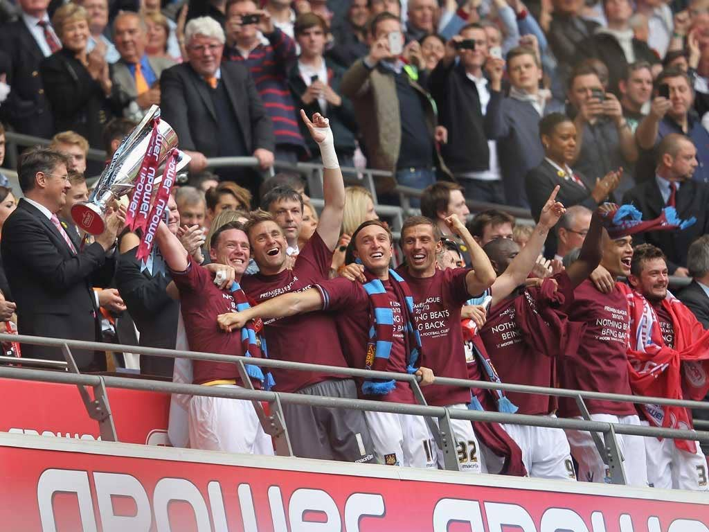 We've done it! Kevin Nolan lifts the trophy after West Ham win 2-1 in the Championship play-off final