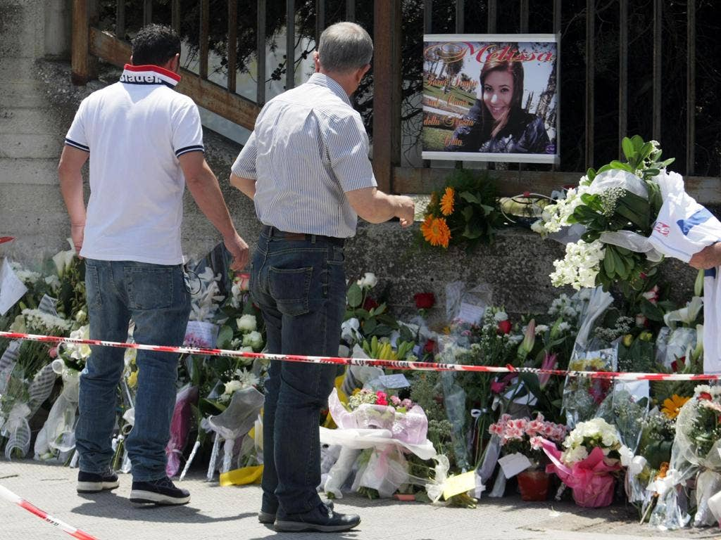 Flowers have been left in memory of the girl who was killed in a bomb attack in Italy