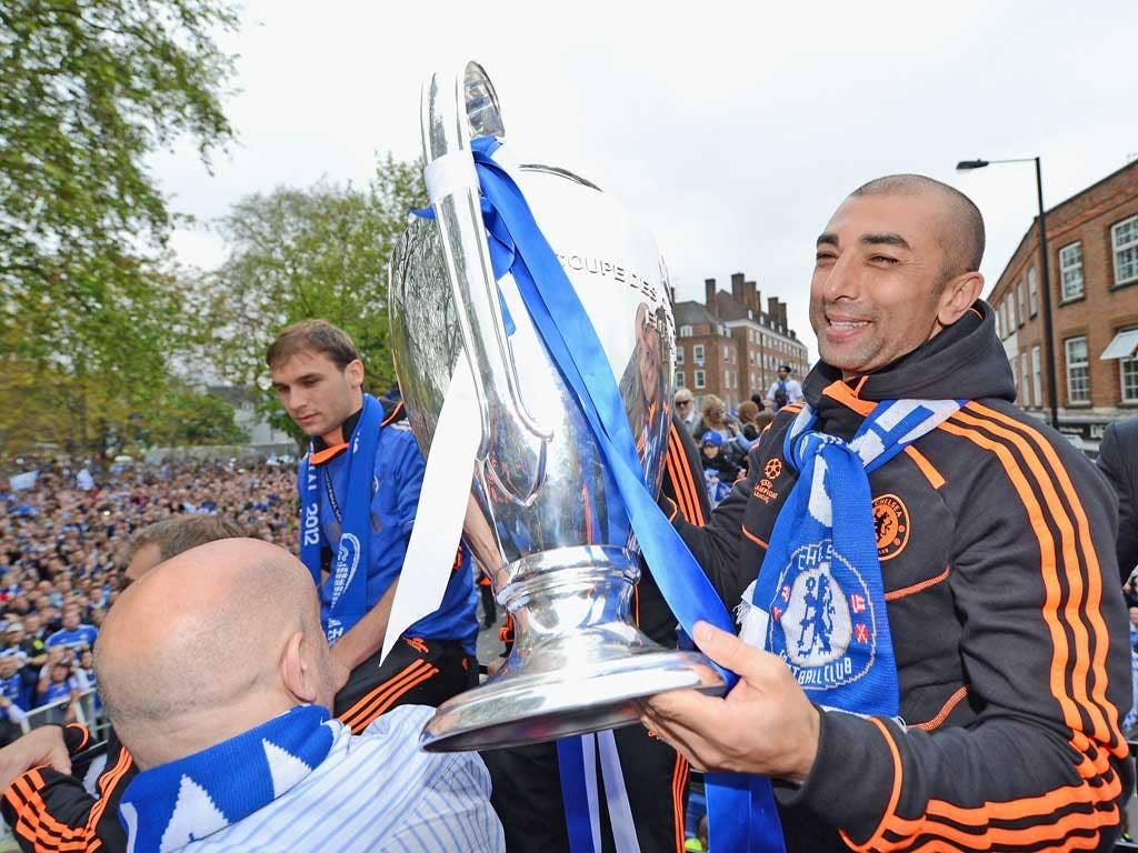 Manager Roberto Di Matteo lifts the Champions League trophy during the Chelsea victory parade