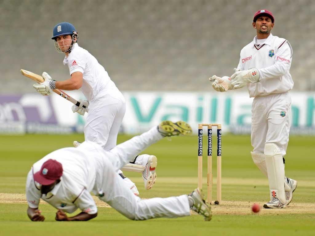 Denesh Ramdin watches Alastair Cook's steer to slips evade West Indies captain Darren Sammy