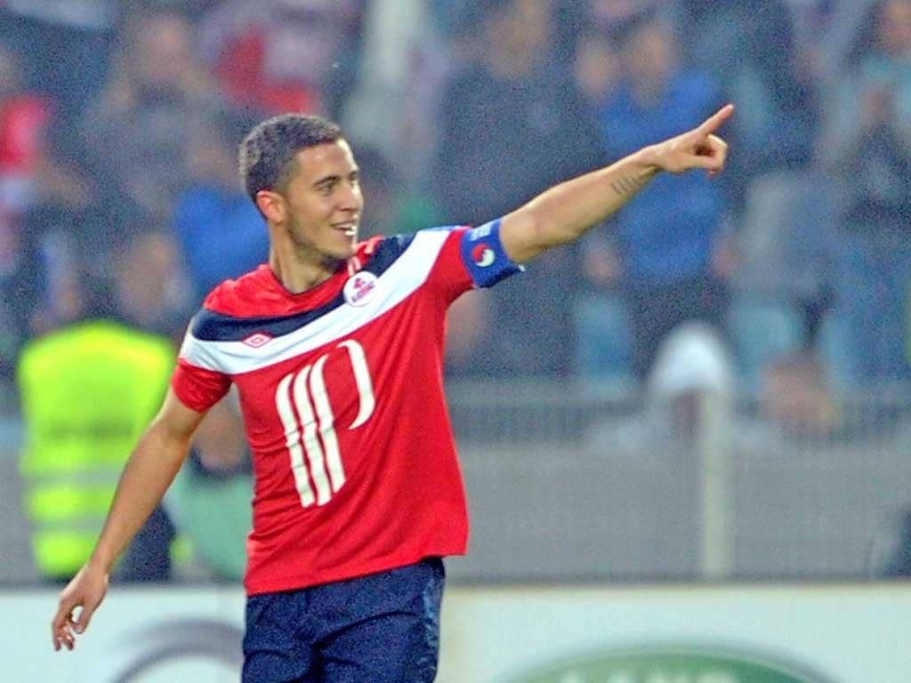 Lille's French midfielder Eden Hazard celebrates after scoring a goal against Nancy