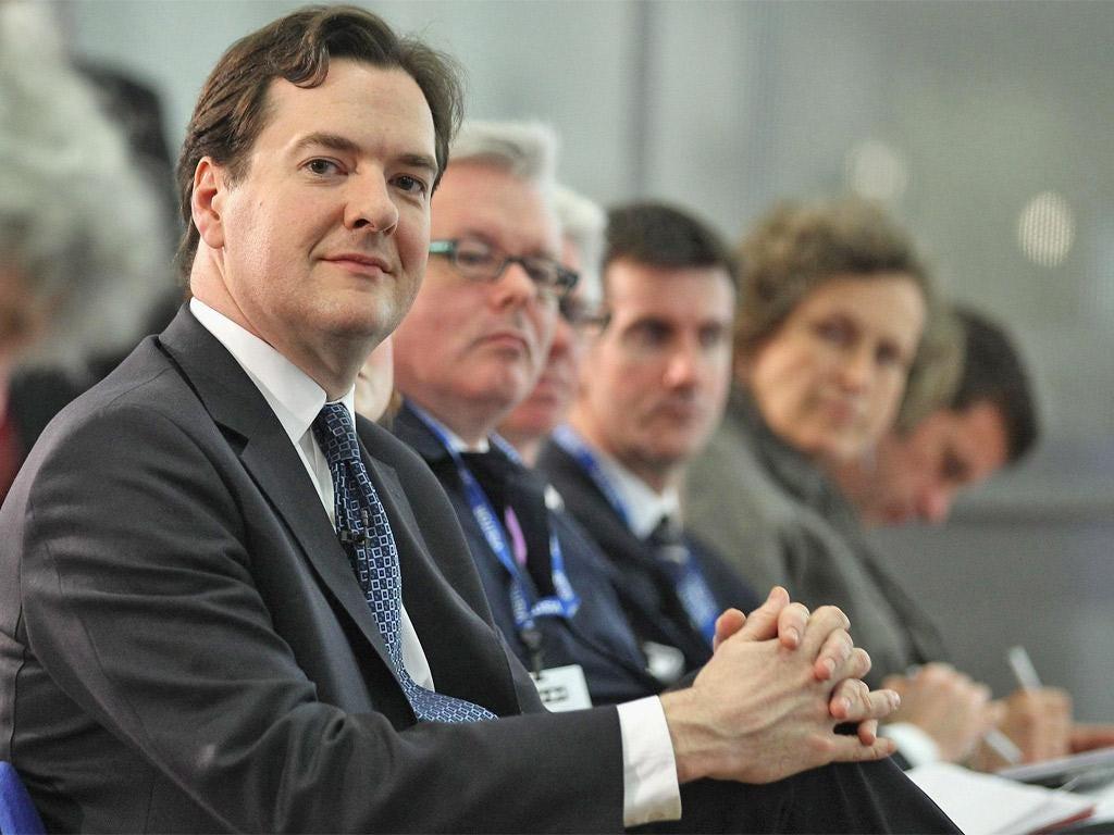 George Osborne listens as IMF chief Christine Lagarde delivers her verdict on the UK economy
