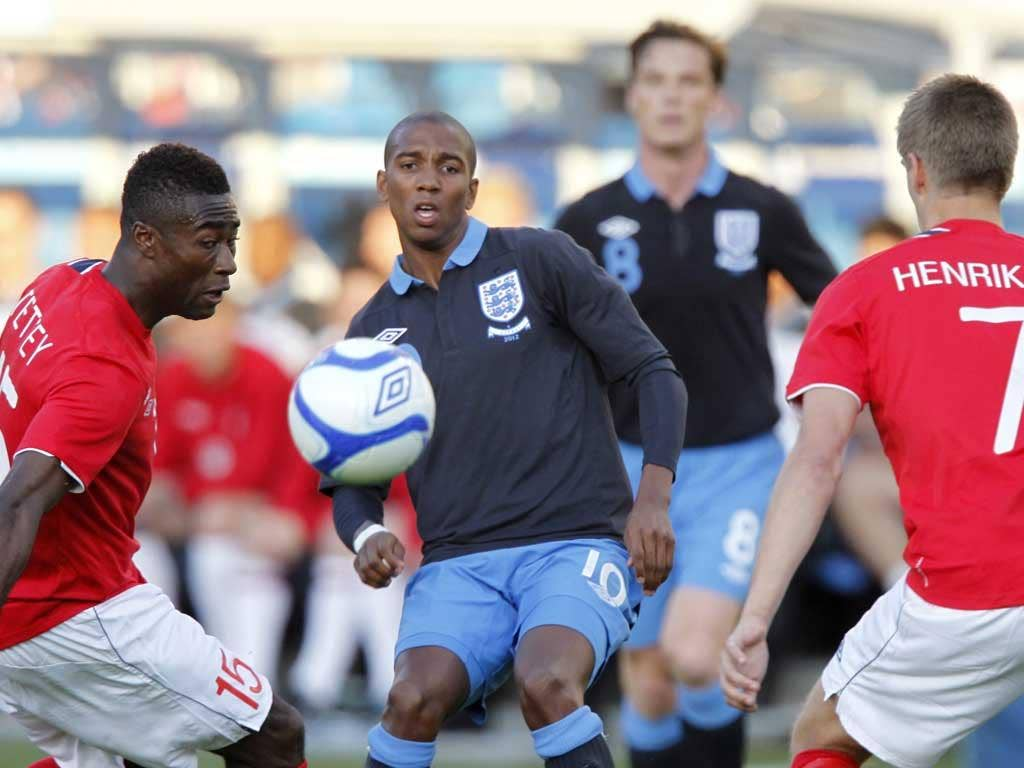 Ashley Young vies for the ball with Norway's Alexander Banor Tettey (left) and Norway's Markus Henriksen