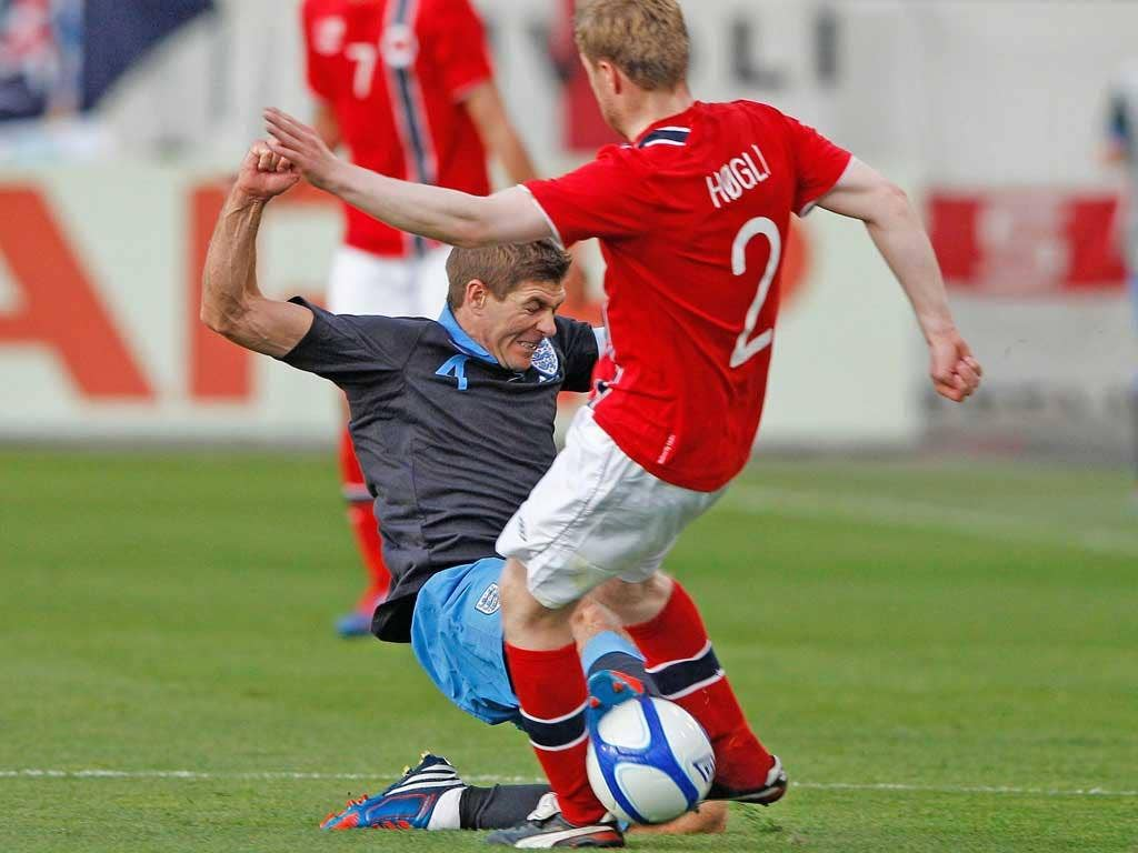 Steven Gerrard could easily have been shown red for the tackle on Tom Hogli