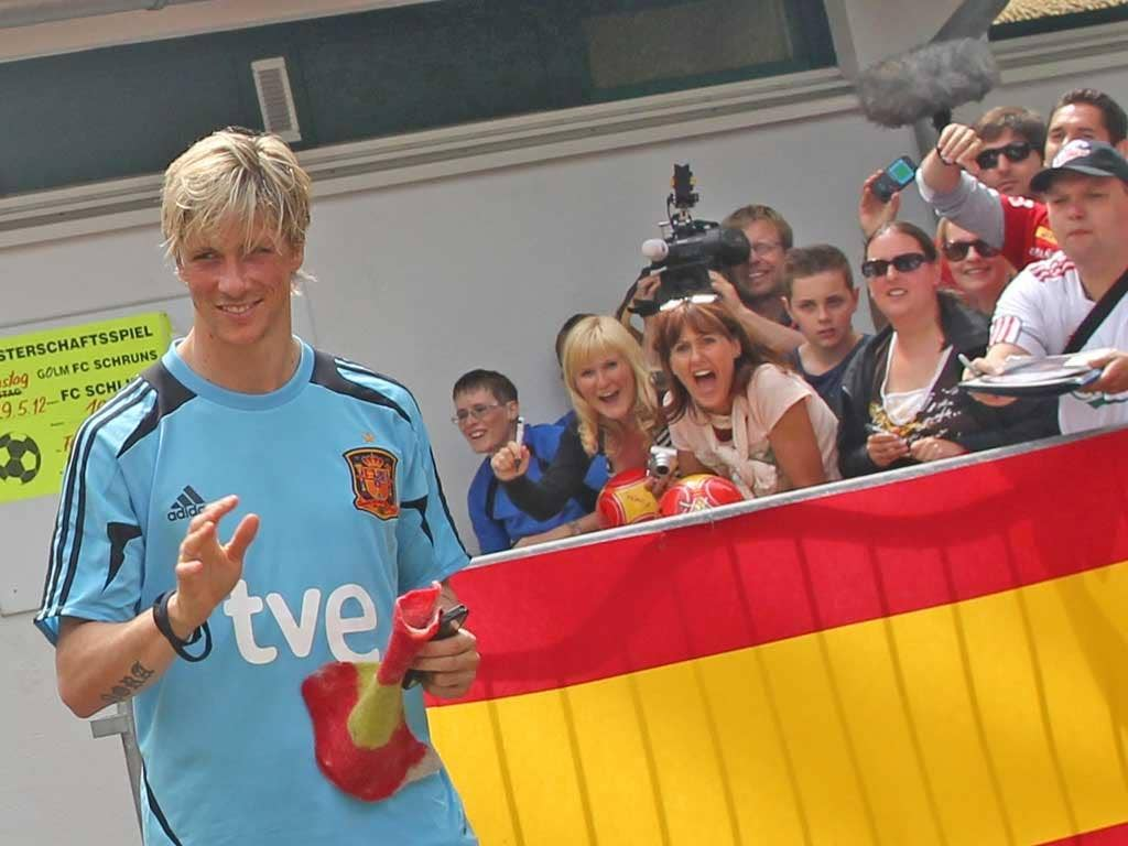 Fernando Torres is the centre of attention as he leaves a Spain training session in Schruns in Austria yesterday