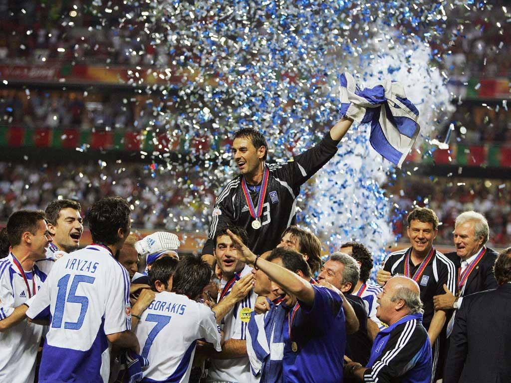 Party time: Greece players celebrate their unlikely triumph against hosts Portugal in the 2004 final in Lisbon, when they took the tournament by storm