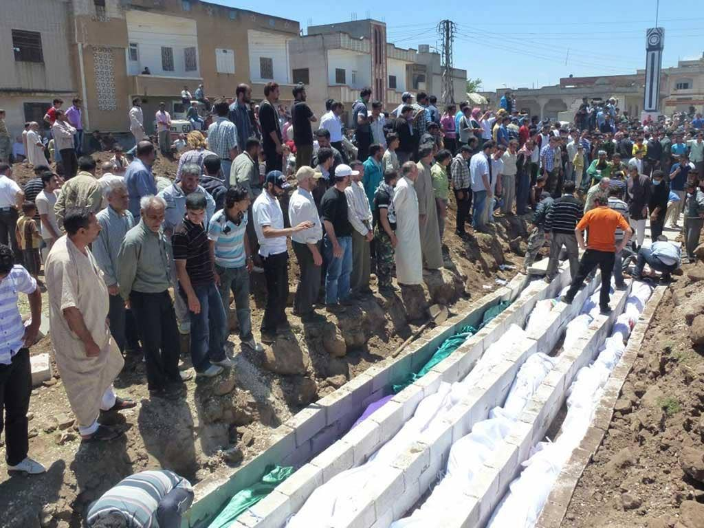 Massacre: The funeral last week of those killed in the city of Houla