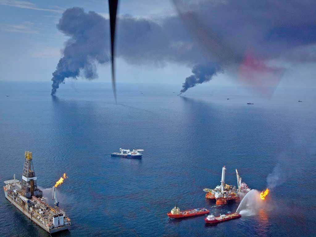 Oil is burned off the surface of the water near the source of the Deepwater Horizon spill in the Gulf of Mexico off the coast of Louisiana, in 2010