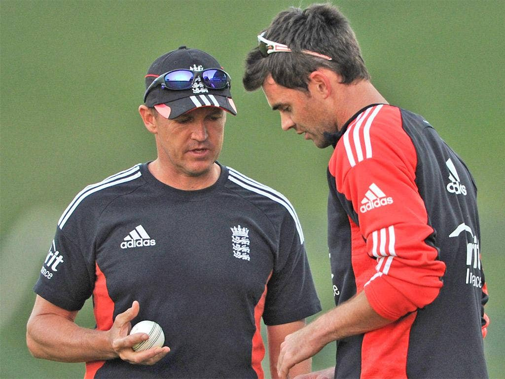 Andy Flower (left) speaks to bowler James Anderson during a nets session last year