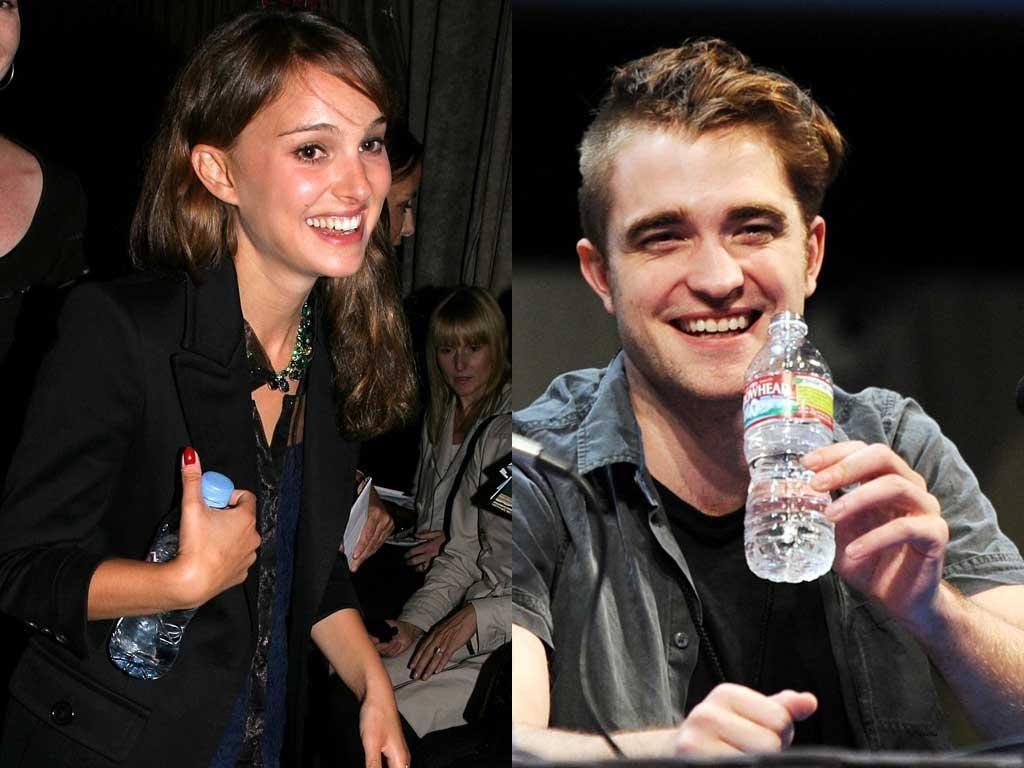 Taking the waters: Bottle-huggers Natalie Portman and Robert Pattinson