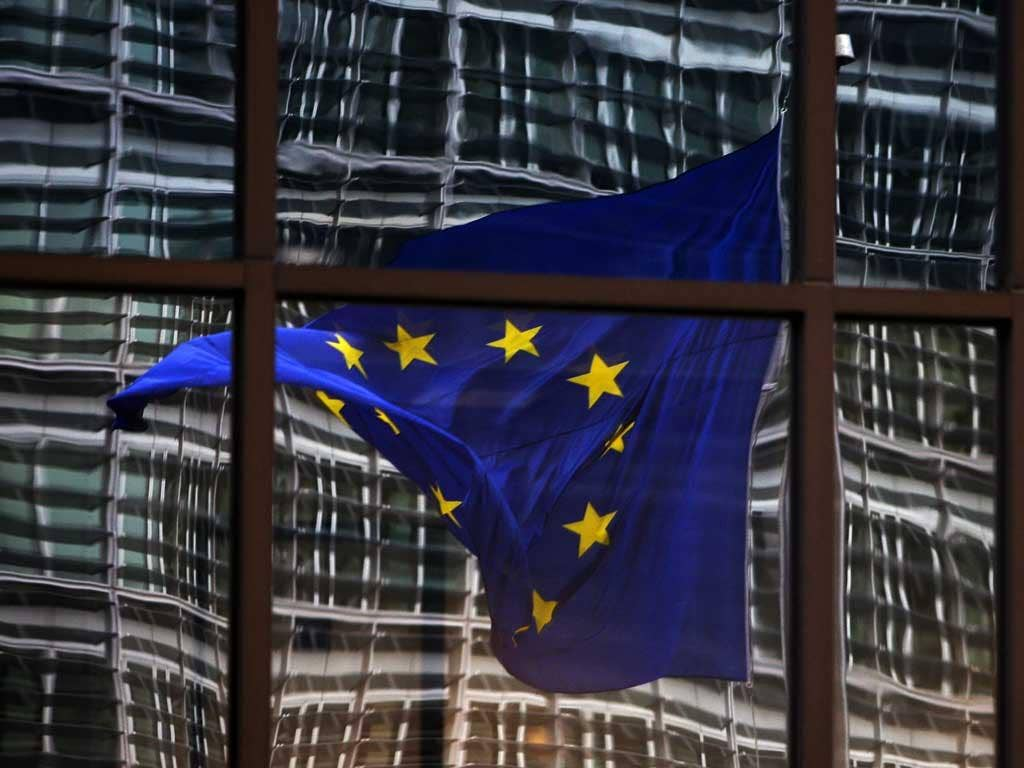 Fluttering: The European flag flies in Brussels, but David Cameron's direction is unclear