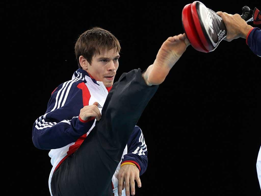 Kick in the teeth: Aaron Cook has fought long and hard to realise his Olympic dream but he appears to have lost out to Lutalo Muhammad for 2012 selection