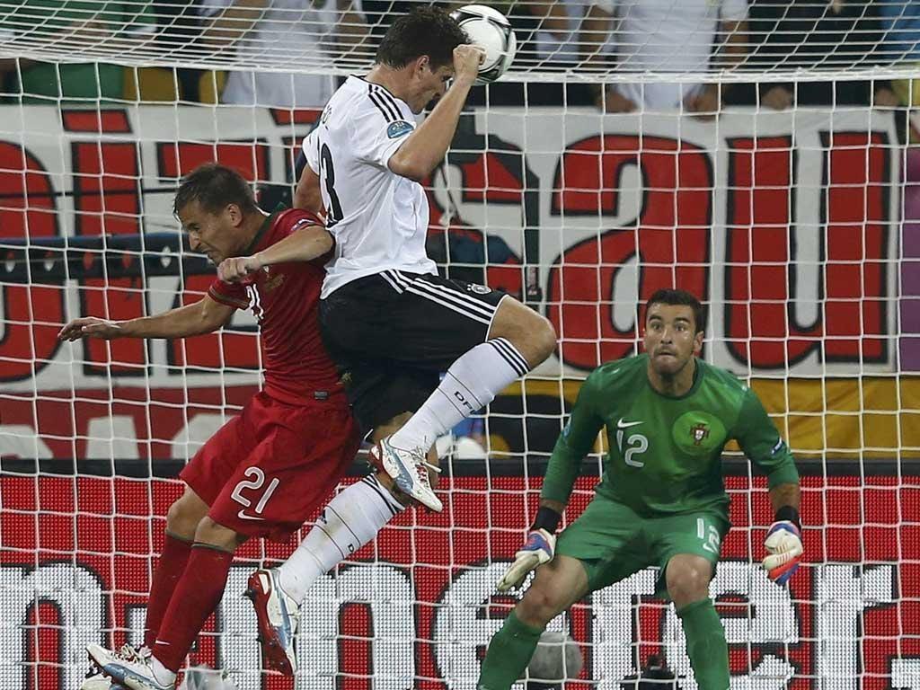 Heads up: A Mario Gomez header powers Germany ahead