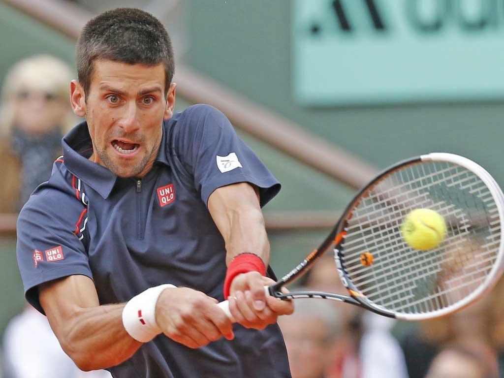 Novak Djokovic plays a backhand as he battles back against Rafael Nadal at Roland Garros