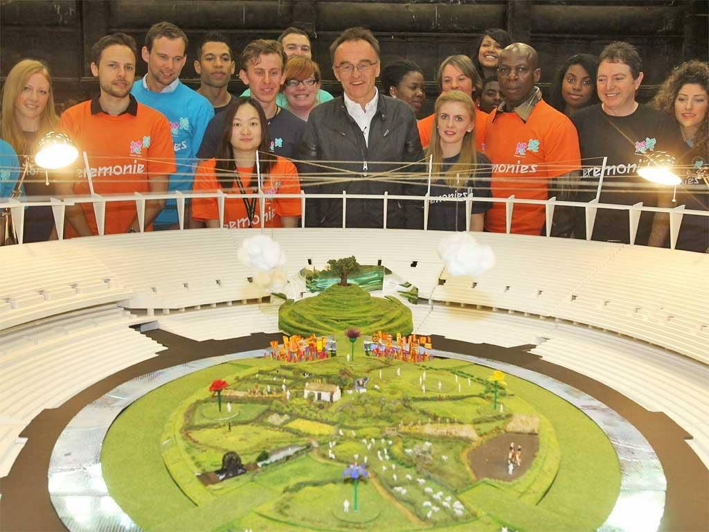 Danny Boyle, with London 2012 crew and volunteers, unveils a model of the Opening Ceremony yesterday