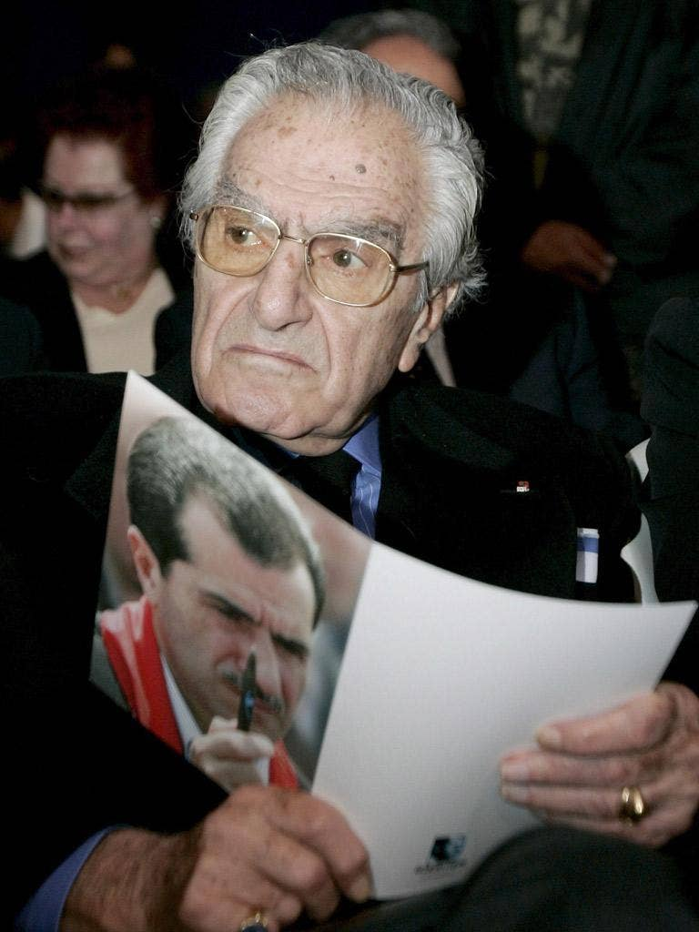 Tueni with a picture of his son Gebran, who was killed by a bomb blast