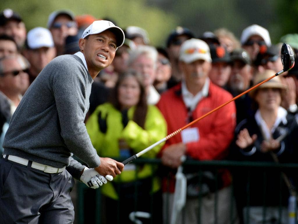 Tiger Woods attracts the early-morning crowds at Olympic yesterday