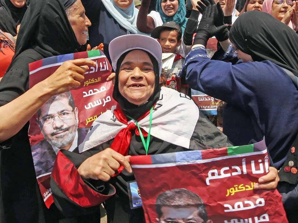 Supporters of Mohamed Morsi, the Muslim Brotherhood candidate, celebrate in Tahrir Square