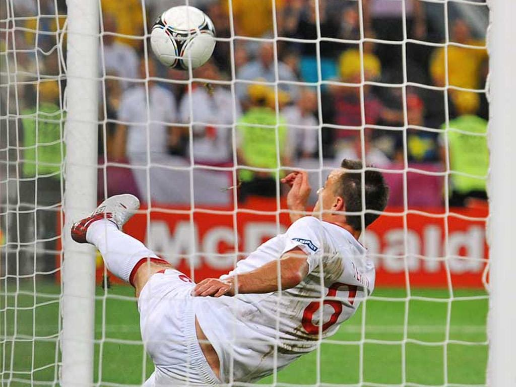John Terry does his best to stop the ball from going over the line