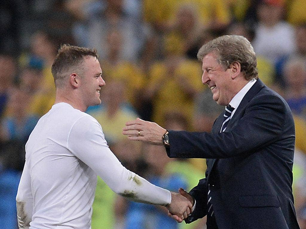 Roy Hodgson and Wayne Rooney at the final whistle against Ukraine