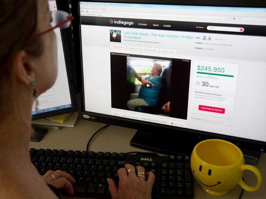 A journalist looks at the website raising money for Karen Klein,an upstate New York school bus monitor