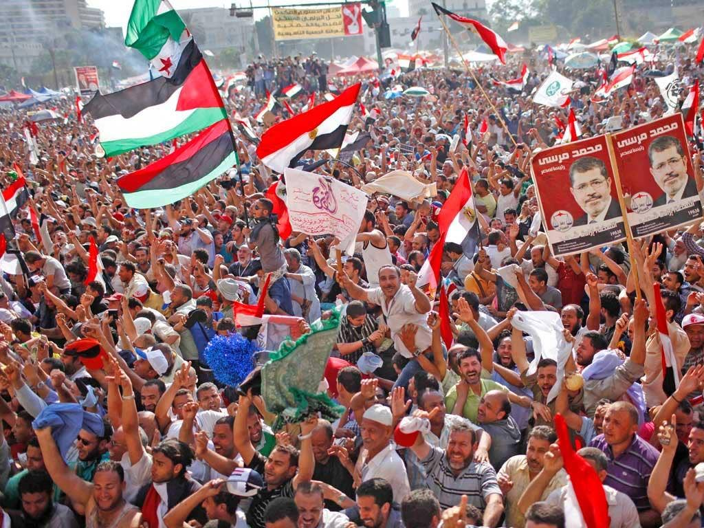 Supporters of the Muslim Brotherhood's candidate Mohamed Morsi celebrating his victory in Tahrir Square yesterday