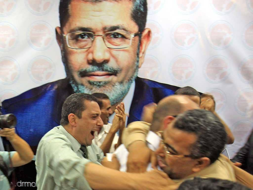 Muslim Brotherhood supporters celebrate Mr Morsi's victory
