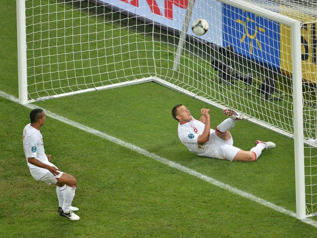 John Terry clears the ball