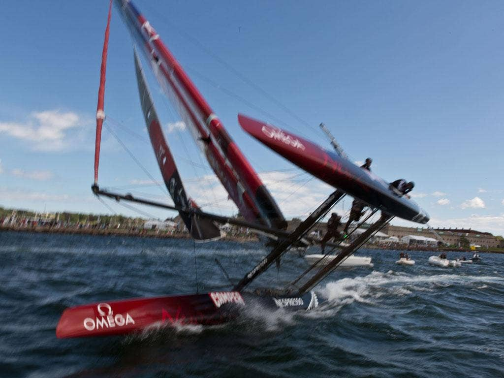 If it looks a little blurred it is because photographer Gilles Martin-Raget was ducking as he took the flying image of Team New Zealand's 45-foot catamaran just before it collided with the boat on which he was standing