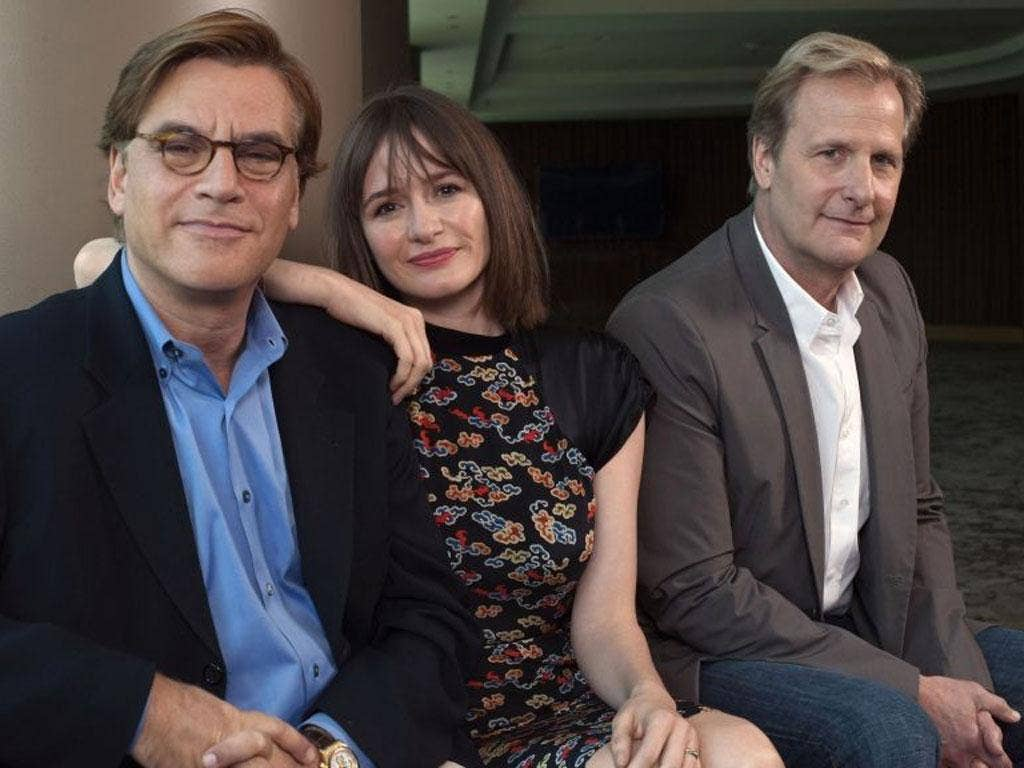 "Producer Aaron Sorkin sits for a photo with cast members Emily Mortimer (C) and Jeff Daniels (R) at the offices of HBO in New York, in this May 17, 2012 file photo. Sorkin's new series ""The Newsroom"" will premier on HBO on June 24. (REUTERS/Keith Bedford/"