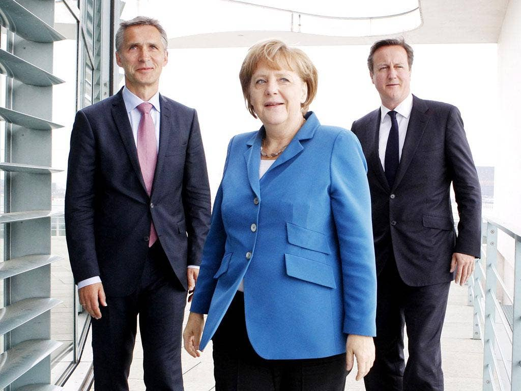 Together alone: Mr Cameron has managed to alienate Ms Merkel