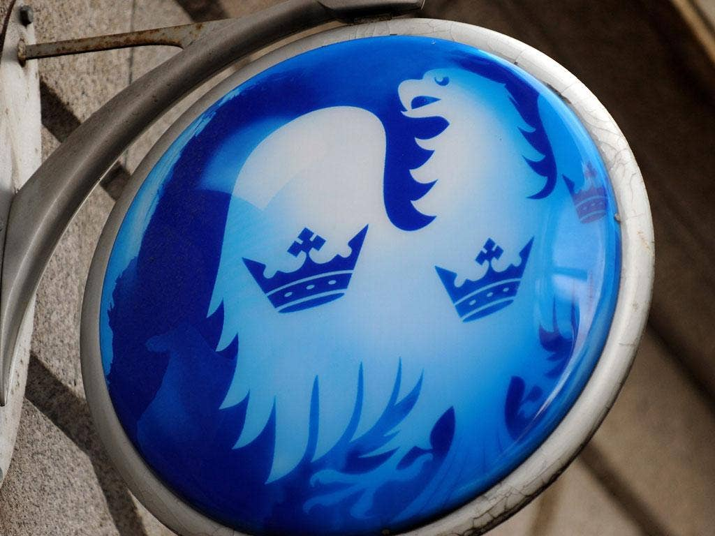 A logo outside a Barclays bank