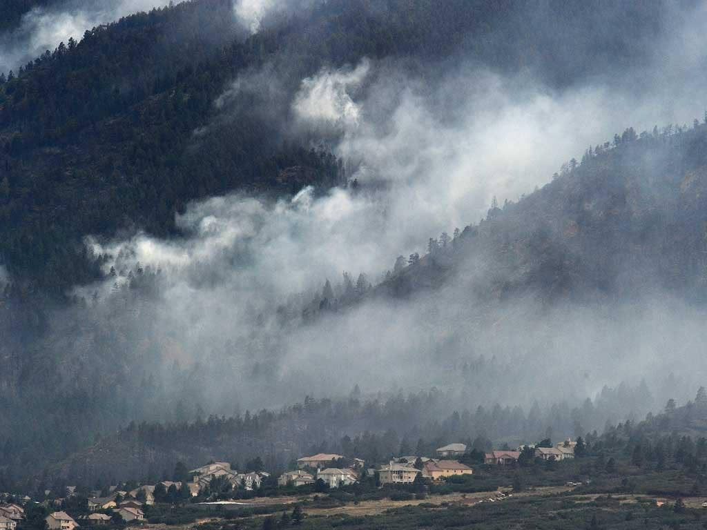 Smoke from the Waldo Canyon fire rises above evacuated homes in Colorado Springs