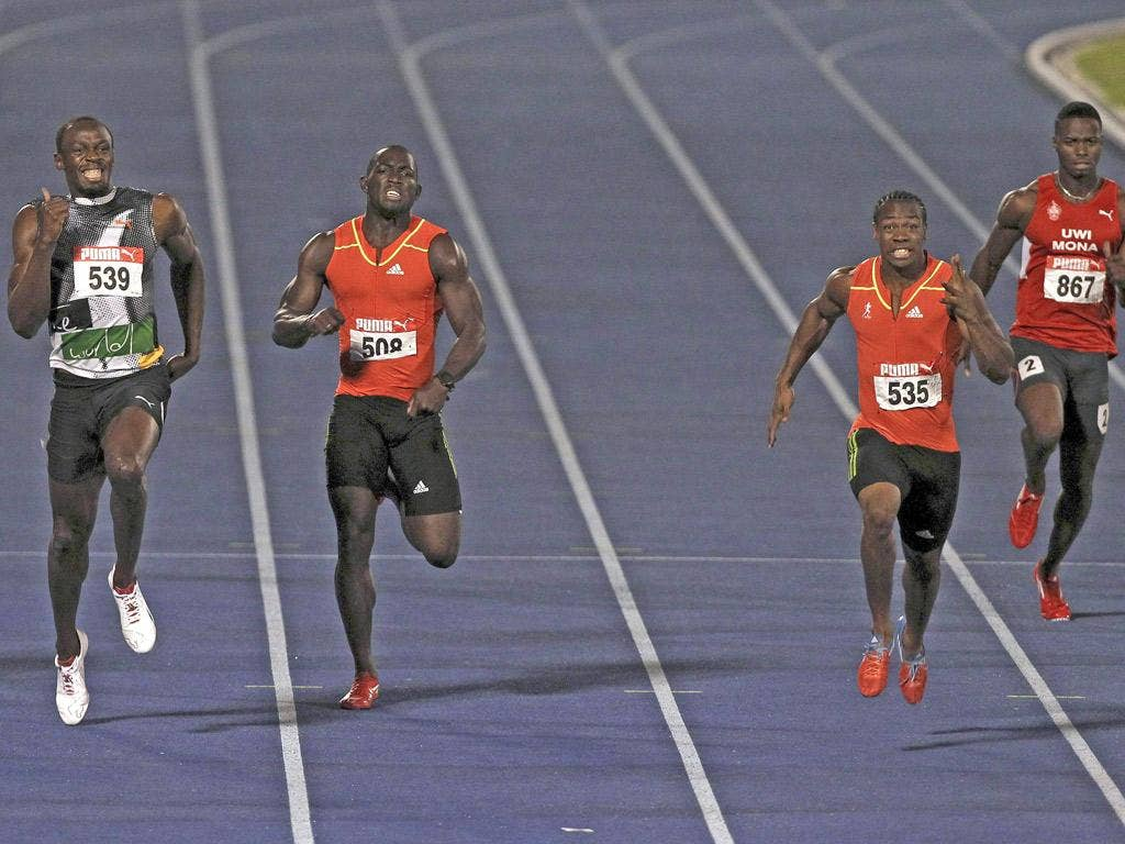 Yohan Blake (second right) beats Usain Bolt in Jamaica's 200m trial