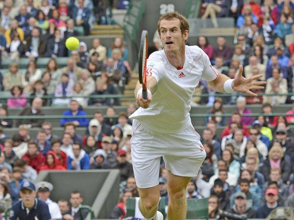 Andy Murray makes a return to Marin Cilic during their rain-interrupted match yesterday