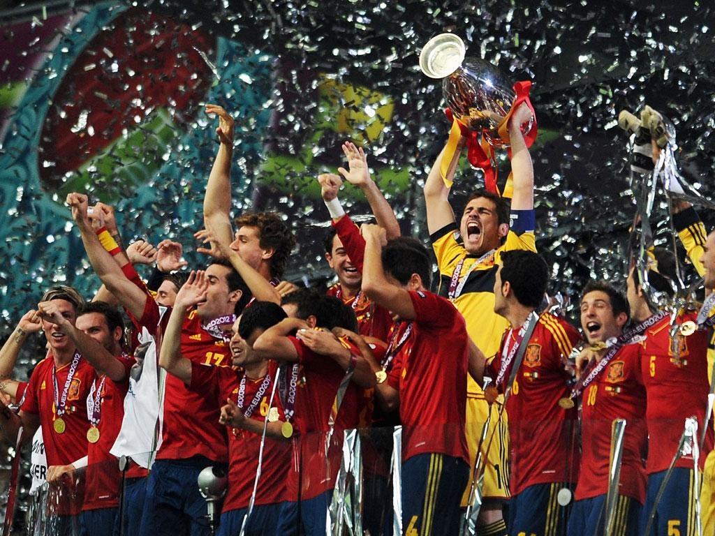Spain captain Iker Casillas lifts the Euro 2012 trophy