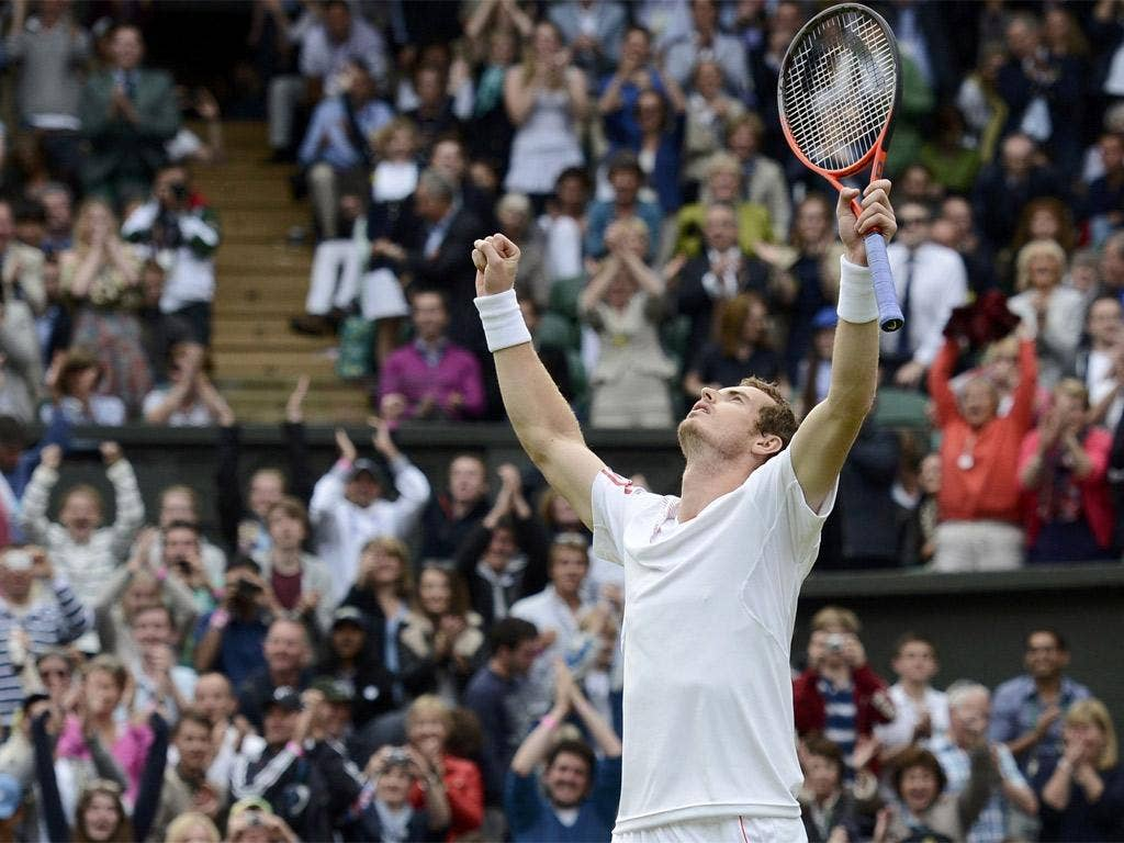 Andy Murray celebrates victory and progression to the semi-finals