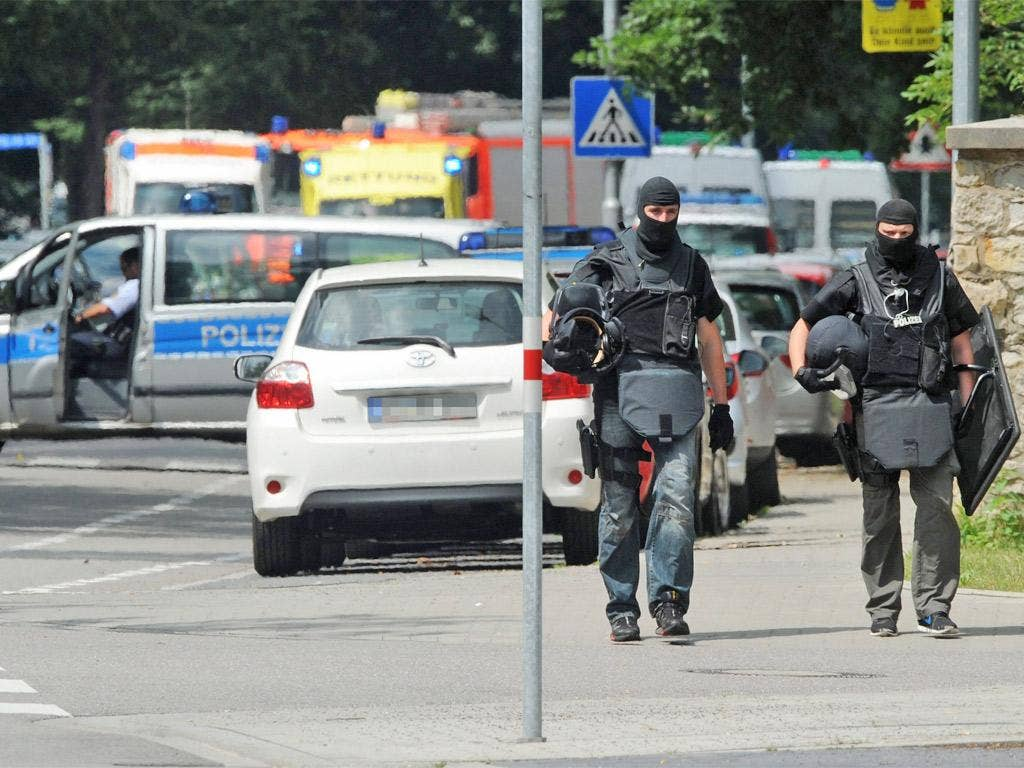 Police commandos outside the scene of the siege in Karlsruhe