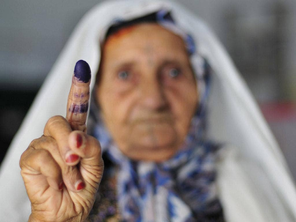 Democratic sign: A voter shows her inked finger after casting her vote in Benghazi yesterday