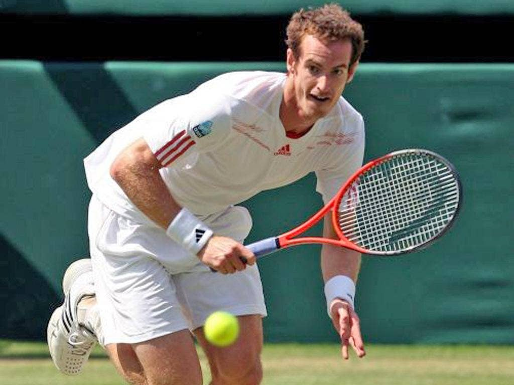 Andy Murray races to make a return against Roger Federer yesterday